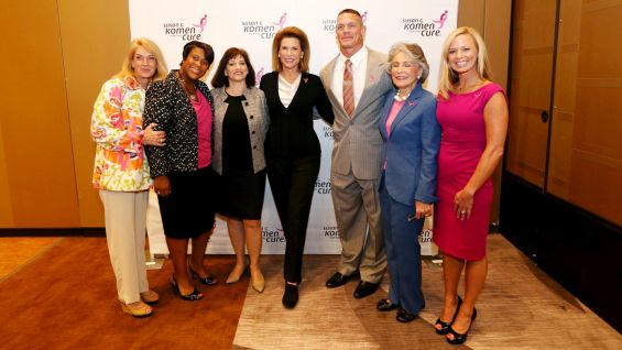 Cena poses with members of Komen's Board of Directors.