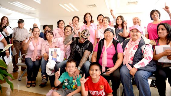 WWE Superstar Rey Mysterio visits with breast cancer survivors and their families at the UNEME Breast Cancer Center in Queretaro, Mexico.