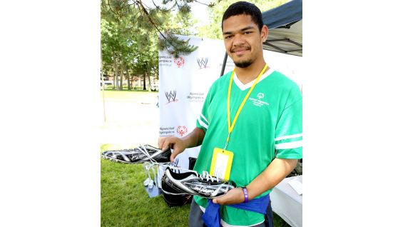 One athlete proudly shows off his autographed shoes.
