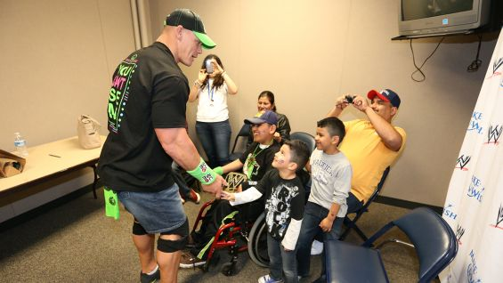 John Cena says hello to Make-A-Wish's Luis.