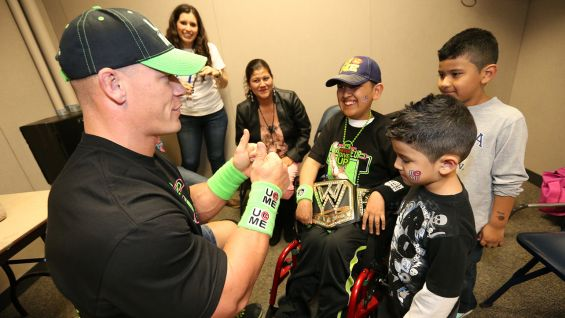 Luis, 11, and his family are thrilled to meet Cena before Raw in Memphis, Tenn.