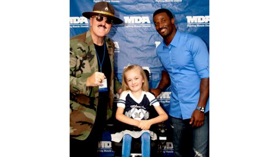 Sgt. Slaughter joins James Jones of the Green Bay Packers and MDA Wisconsin State Ambassador Reagan Imhoff.