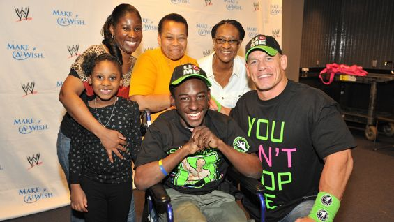 The Circle of Champions honoree and his family are all smiles with Cena.