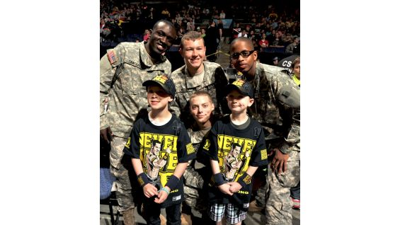 The Wish kids pose with U.S. troops at Raw in Columbus, Ohio.