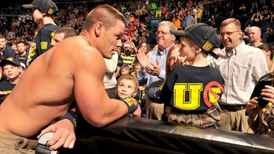 Cena greets the honorary WWE Superstars.