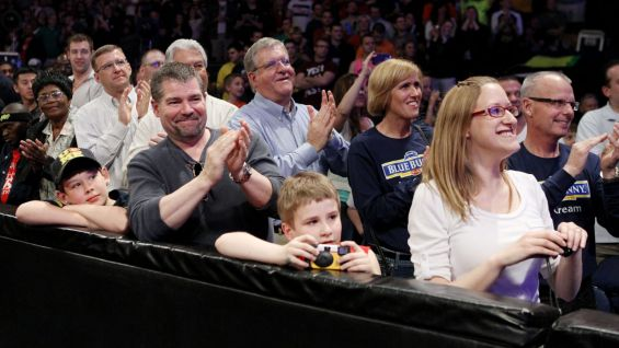 The Wish kids' families look on as their children become honorary WWE Superstars on Monday Night Raw.