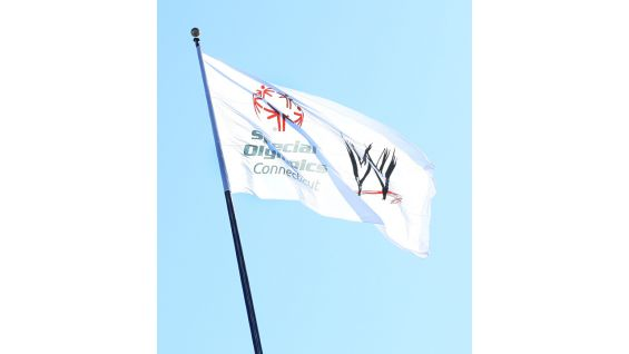The Special Olympics Connecticut and WWE logos fly high over WWE Headquarters for the the torch run rally!
