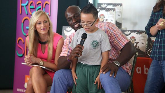 Summer Rae and Titus O'Neil host a Reading Celebration during SummerSlam Week in Los Angeles.
