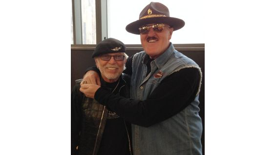 Slaughter poses with Willie G. Davidson, the son of former Harley-Davidson President William H. Davidson and the grandson of Harley-Davidson co-founder William A. Davidson.