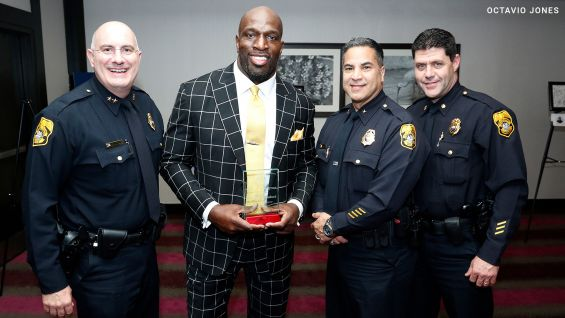 Tampa Police Chief Brian Dugan, left, and the Tampa Police Department with O'Neil.