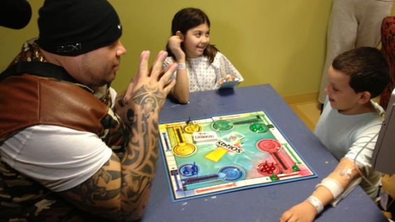 Brodus Clay visits kids at the Hackensack University Medical Center.