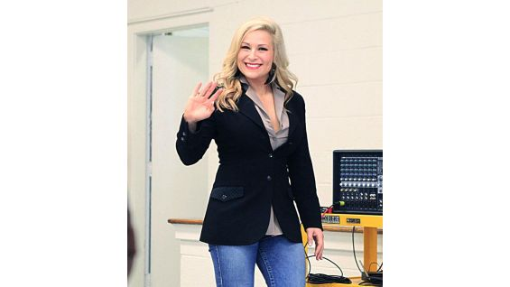 Natalya greets the students at Mary Ford Elementary School.