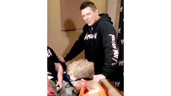 The Miz greets Dylan, 9, of Make-A-Wish Foundation.