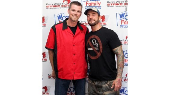 "Recently retired Chicago Cubs pitcher Kerry Wood and WWE Champion CM Punk pose for a photo during Wood's seventh annual ""Strike Zone Celebrity Bowling Tournament."""