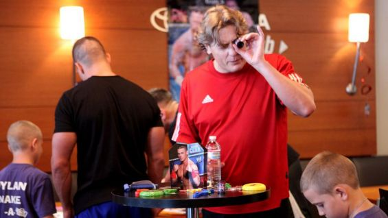 William Regal checks out the WWE-themed party supplies courtesy of Party City.