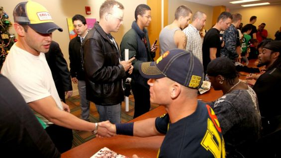 Wwe superstars and divas meet us troops before the traditional john cena greets military members of the cenation at the iowa estates m4hsunfo