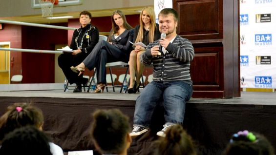 Hornswoggle explains the importance of showing tolerance and respect for each other to the students at Hope-Hill Elementary School in Atlanta.