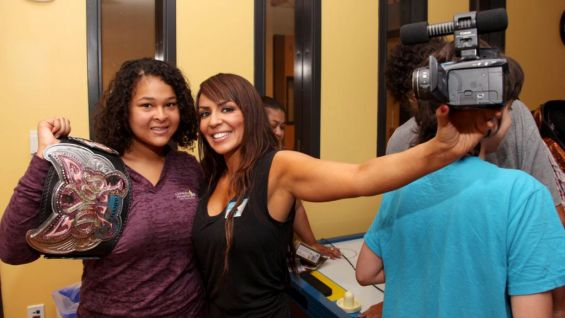 Divas Champion Layla and a lucky fan smile for the cameras.