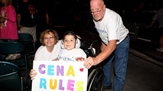 Jonathan and his parents, Ruth and Charlie, show their support for Cena.