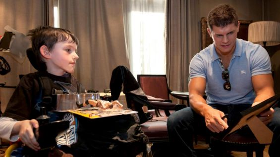 The WWE Superstar signs autographs for the young WWE fan.