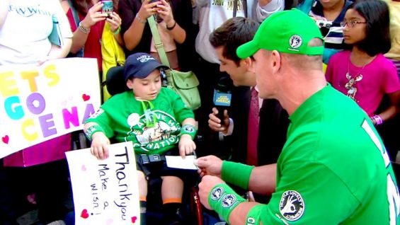 """While on """"Good Morning America,"""" Jonathan Littman from Make-A-Wish gets a welcome surprise from John Cena, who comes bearing gifts for the youngster: tickets to Raw's 1,000th episode July 23."""