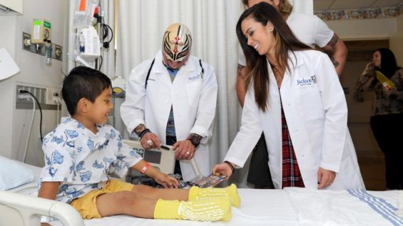 AJ joins Mysterio to visit with this child.