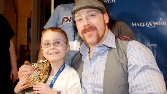 Sheamus poses with an aspiring WWE Champion.