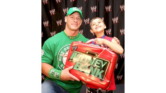 Cena and Joseph pose with the Money in the Bank briefcase just hours before the Superstar cashed in against WWE Champion CM Punk.
