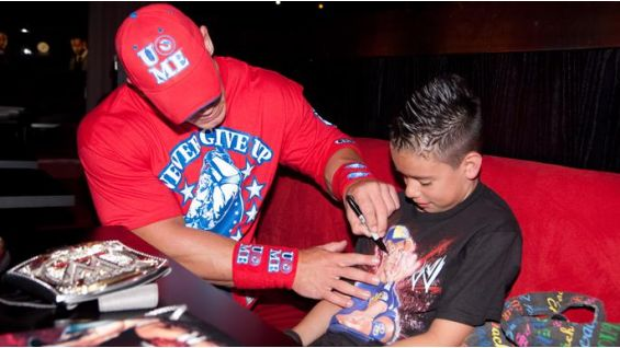 Cena signs Angel Diaz's WWE shirt.
