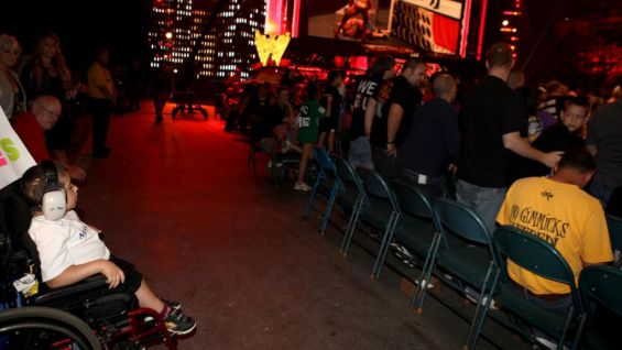 The youngster watches Raw SuperShow at Nassau Coliseum in Long Island, N.Y.