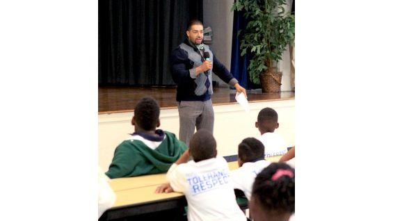 Otunga talks to the fourth- and fifth-graders about WWE and the Creative Coalition's be a STAR Alliance to help end bullying.