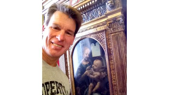JBL poses with a daVinci painting.