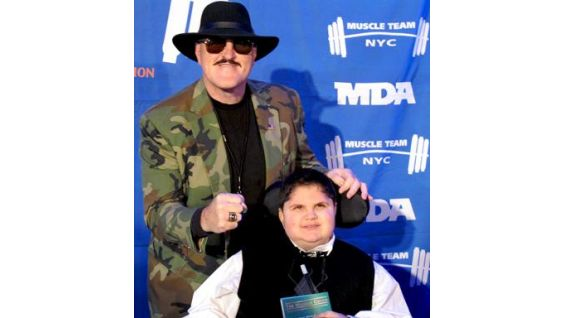 The WWE Hall of Famer poses with his MDA Buddy, a local child living with muscular dystrophy.