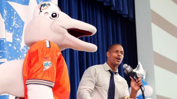 Dolphins mascot T.D., and Director of Youth and Community Programs Twan Russell take a moment to address the young audience as well.