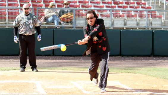 He takes the field at the International Softball Federation World Headquarters in Plant City, Fla.
