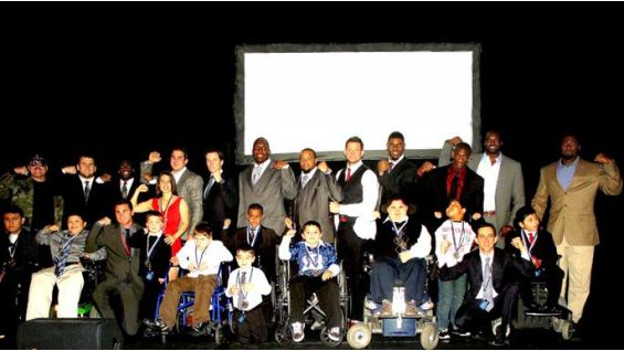Athletes and celebrities at the event pose with their MDA Buddies.