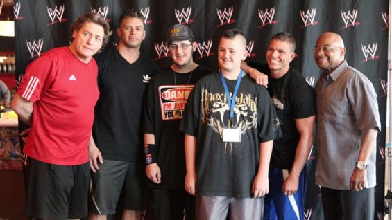 Make-A-Wish's Josh and his brother pose with some of his new Superstar friends.