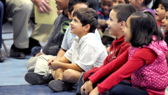 The students at Isaac Imes Elementary School in Glendale, Ariz., await the Superstars' arrival before the reading rally.
