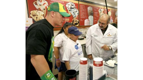 Cena helps Derek make his own customized Cold Stone dessert.