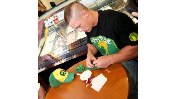 Cena signs WWE gear for Circle of Champions honoree Derek.
