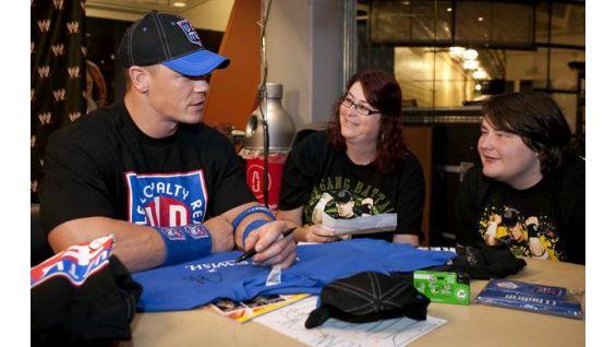 Brian Delvecchio, 17, of Chesapeake, Va., chats with Cena in Charlotte.