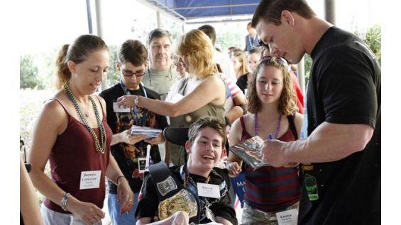 Cena signs an autograph at WrestleMania 24 in Orlando.