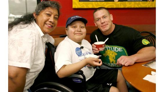 Derek Aguas, 12, of Salinas, Calif., with Cena at Cold Stone in Phoenix.