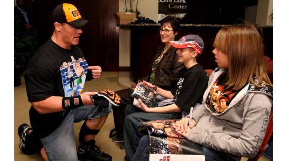 Wheslay Martin, 15, of Langdon, Alberta, Canada, meets John Cena.