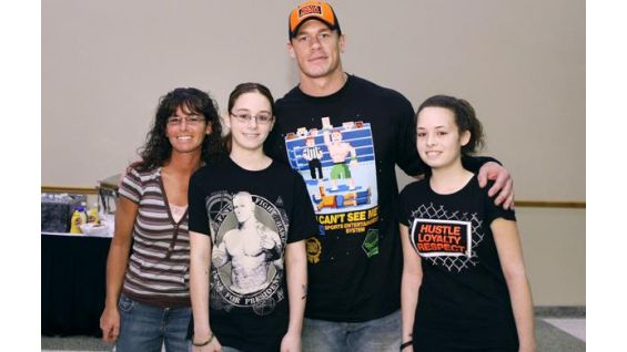 Circle of Champions honoree Ashley Nida, 14, and her family meet Cena.
