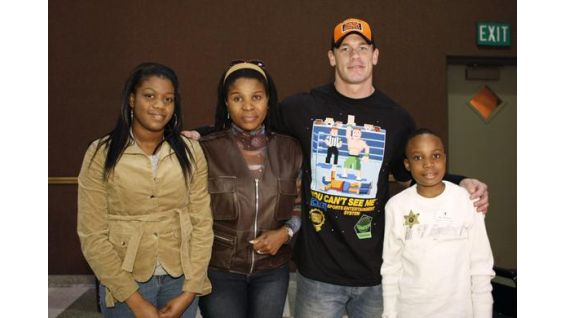 Shine Ogiemwayne, 9, and his family meet John Cena in March 2008.