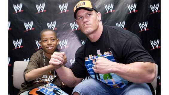 Cena meets Dominique Wilkins, 15, in Kansas City in May 2008.