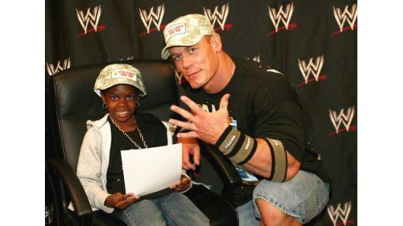 Latiauna Davis, 10, of New Brunswick, N.J., meets Cena in July 2008.