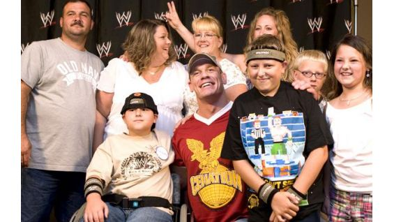 Jacob Kitchens, 10, and Joshua Odle, 12, with Cena.