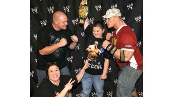 Cody McClellan, 10, of Louisville, Ky., and his family, with Cena.
